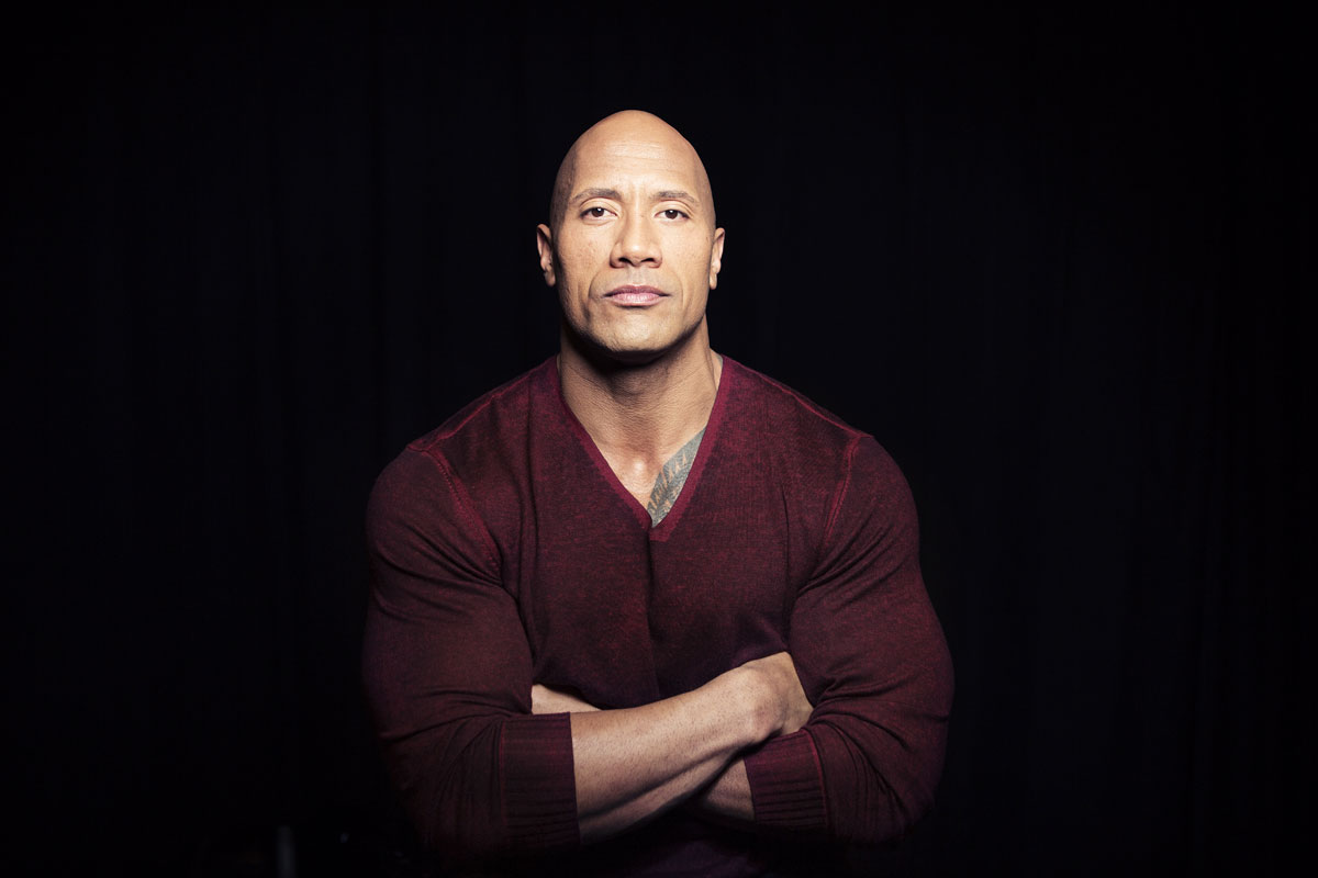 "In this Dec. 8, 2014 photo, Dwayne ""The Rock"" Johnson poses in New York to promote his TNT reality series ""Wake Up Call,"" premiering Friday at 9 p.m. ET. Johnson, 42, will help people who are down on their luck to get their lives on track. (Photo..."