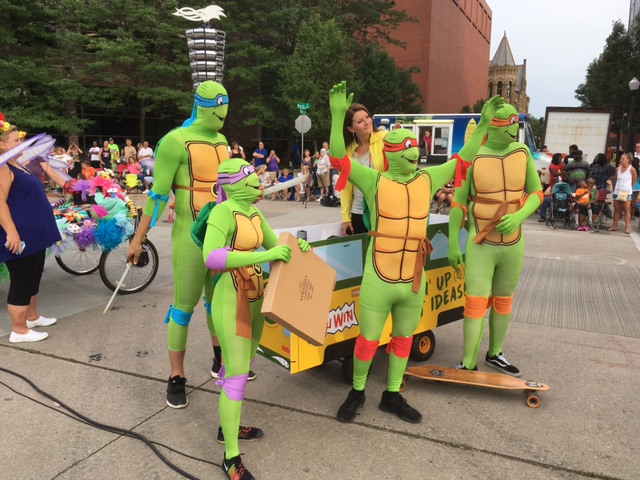 """A five """"turtle"""" team enjoys the festivities of the annual TRF Bed Races."""