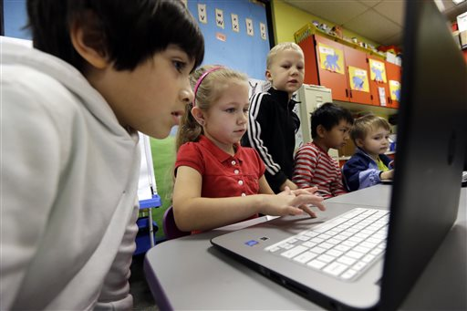 Kindergartners learn computing. (AP Photo/Elaine Thompson)