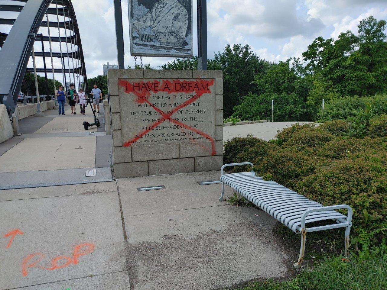 Man arrested for spray painting MLK bridge, statue