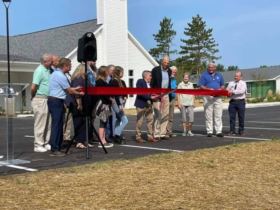 Mike Haarer, vice president and executive director of Compass Rose Academy, cuts the ribbon in celebration of the new facility.
